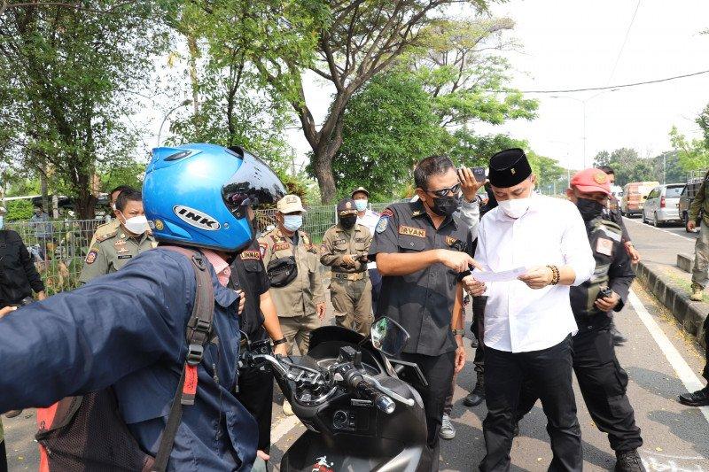 Pekerja migran penyebab lonjakan covid di bangkalan?